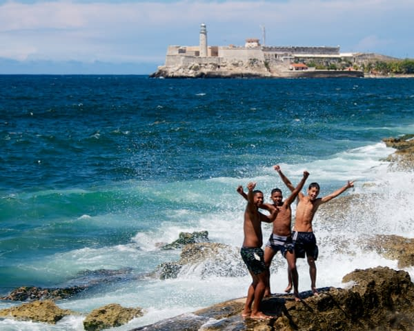 Kids-Playing-on-the-Rocks-with-El-Morro-Havana-Cuba-Copyright-2013-Ralph-Velasco
