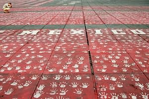 Mexico and Handprints in Zocalo by Ralph Velasco