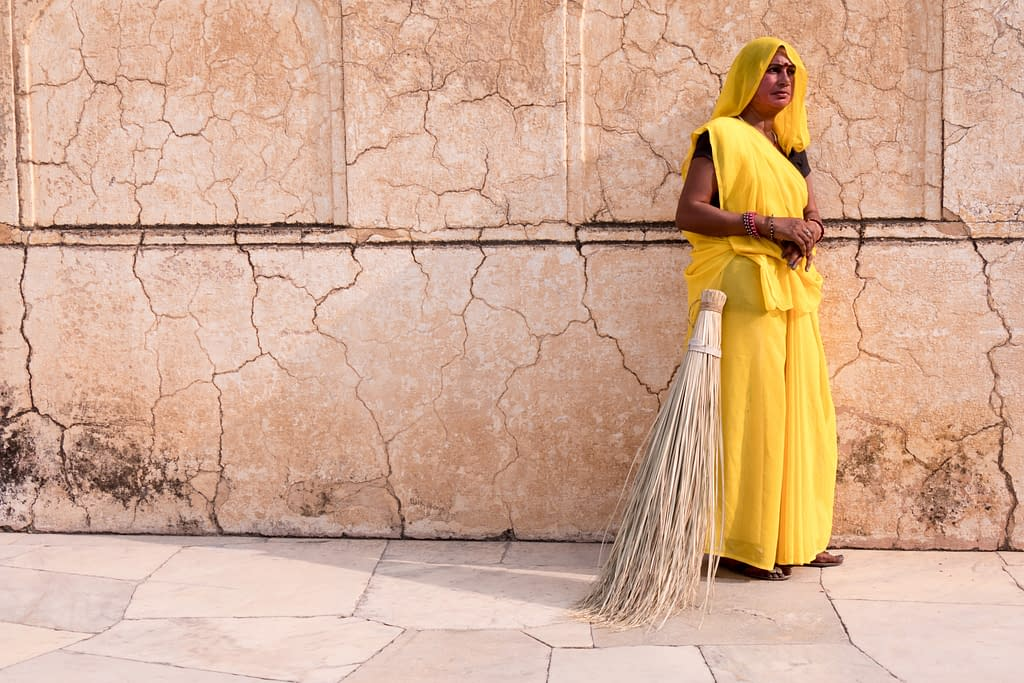 woman-in-yellow-with-broom-at-amber-fort-jaipur-india-copyright-2016-ralph-velasco