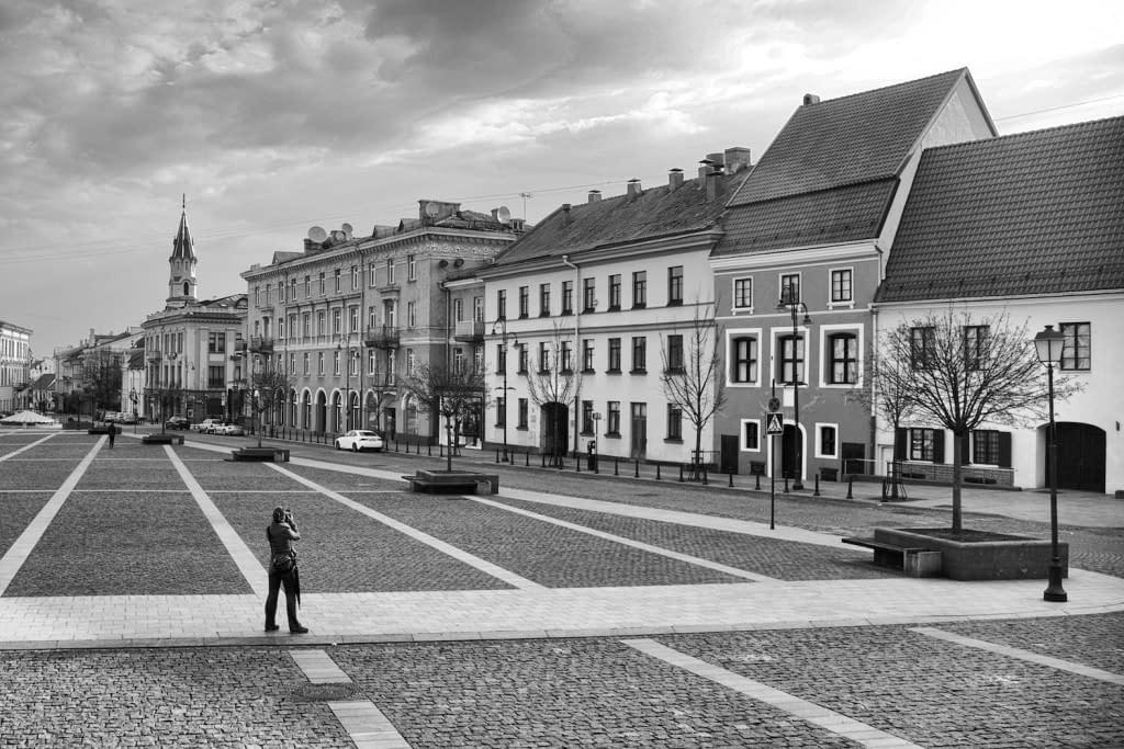 Lone-Photographer-in-Square-in-Black-and-White-Vilnius-Lithuania-Copyright-2015-Ralph-Velasco-1024x683