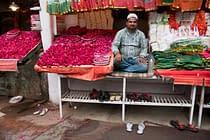 man-sitting-in-offering-stall-in-nizzamudin-delhi-india-copyright-2018-ralph-velasco