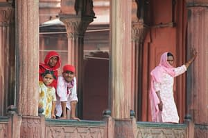 family-in-red-with-lady-in-pink-delhi-india-copyright-2011-ralph-velasco